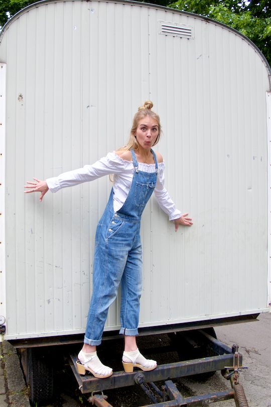 Denim Overall. Fashion Blogger Girl by Style Blog Heartfelt Hunt. Girl with half-up half-down knot wearing a cute denim overall, off-shoulder blouse and Swedish Hasbeens.