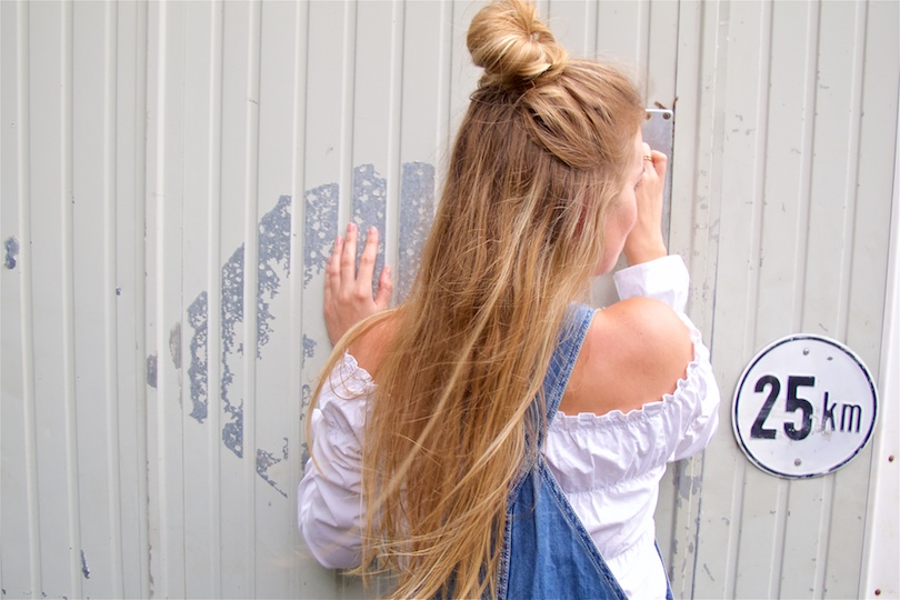 Denim Overall. Fashion Blogger Girl by Style Blog Heartfelt Hunt. Girl with half-up half-down knot wearing a cute denim overall and off-shoulder blouse.