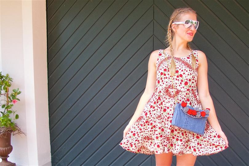 Denim Pompon Bag. Fashion Blogger Girl by Style Blog Heartfelt Hunt. Girl with two blond pigtail braids wearing a flower dress, red espadrilles, Mykita sunglasses and denim pompon bag.