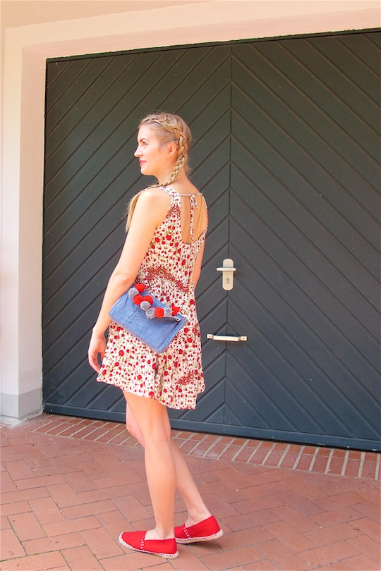 Denim Pompon Bag. Fashion Blogger Girl by Style Blog Heartfelt Hunt. Girl with two blond pigtail braids wearing a flower dress, red espadrilles and denim pompon bag.