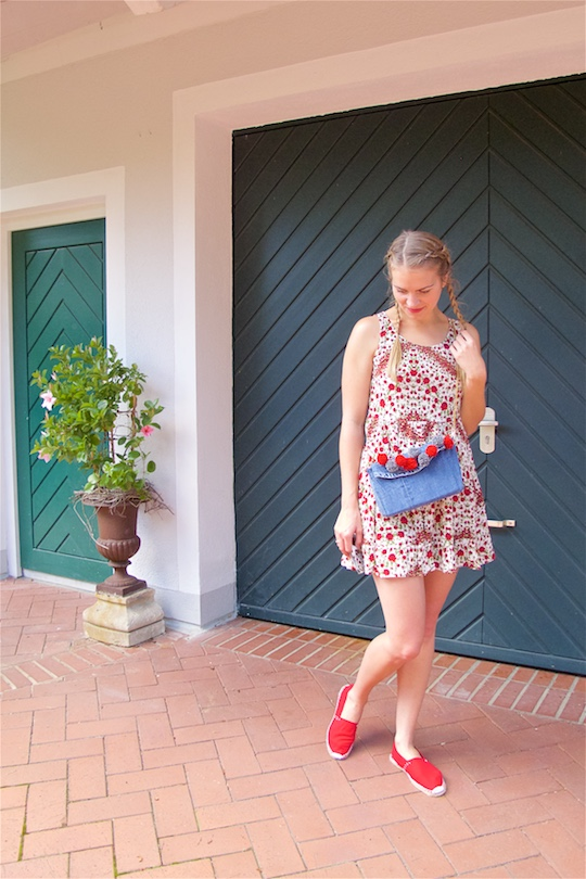 Denim Pompon Bag. Fashion and Style Blog Girl from Heartfelt Hunt. Girl with two blonde pigtail braids wearing a flower dress, red espadrilles, Mykita sunglasses and denim pompon bag.