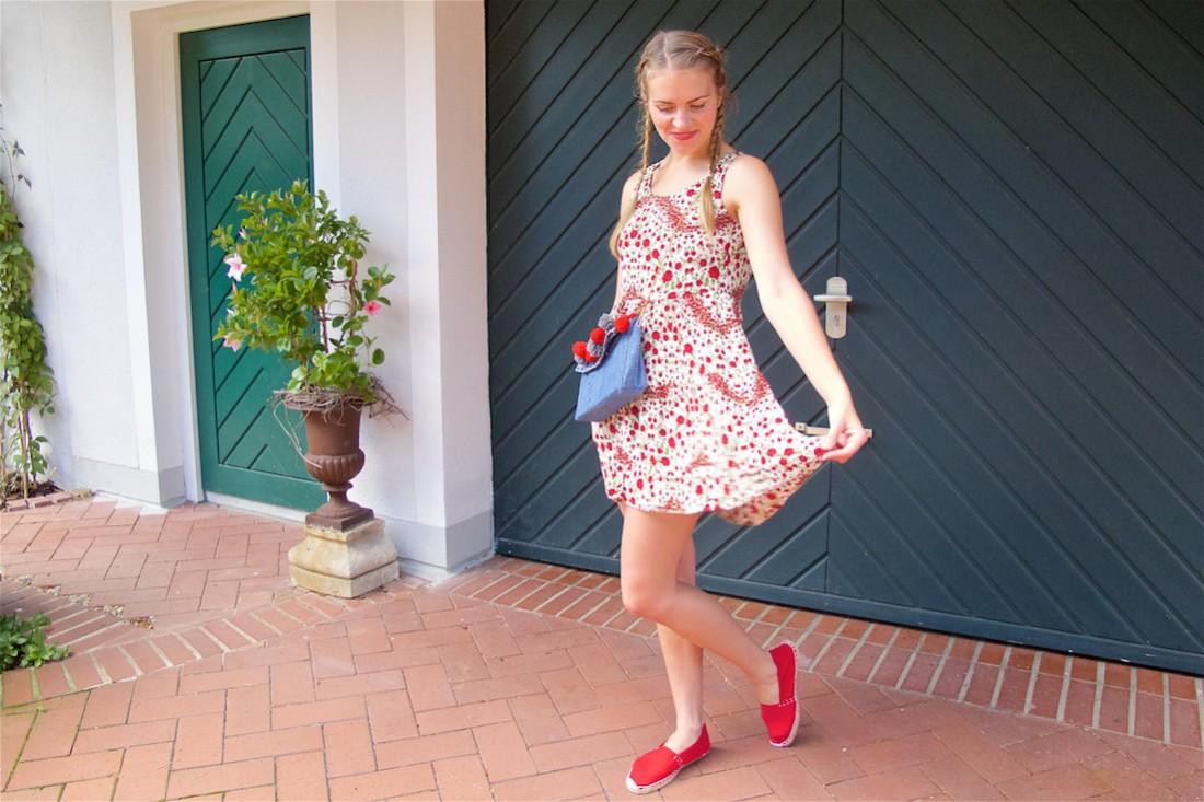 Denim Pompon Bag. Fashion Blogger Girl by Style Blog Heartfelt Hunt. Girl with two blond pigtail braids wearing a flower dress, red espadrilles and denim pompon bag.