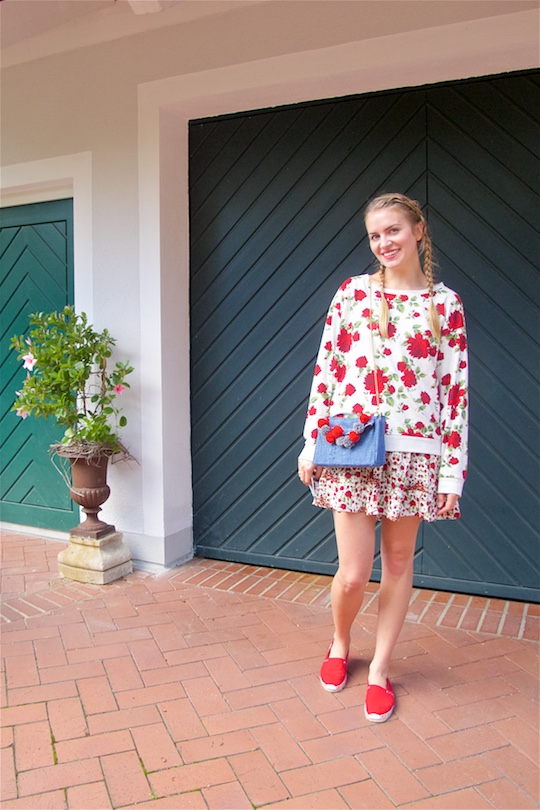 Denim Pompon Bag. Fashion and Style Blog Girl from Heartfelt Hunt. Girl with two blonde pigtail braids wearing a flower dress, flower sweater, red espadrilles, Mykita sunglasses and denim pompon bag.