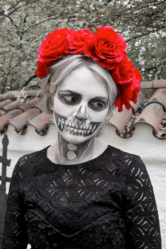 Día De Los Muertos. Fashion and Style Blog Girl from Heartfelt Hunt. Girl with blonde halo braid wearing a black cocktail dress, tulle dress, petticoat, lace top with trumpet sleeves, boots and flower crown for a Day of the Dead or Halloween look.