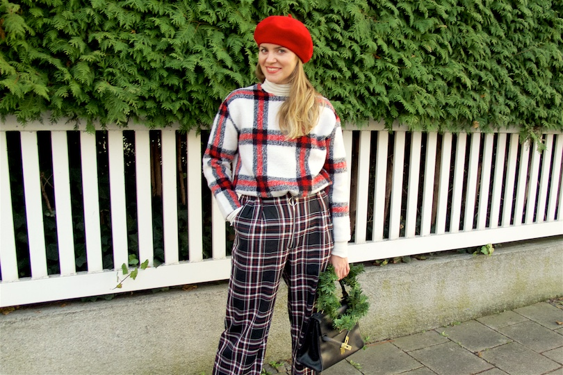 Double Checked. Fashion Blogger Girl by Style Blog Heartfelt Hunt. Girl with blond hair wearing a checked sweater, checked pants, turtleneck sweater, red beret, vintage MCM bag and black flats.