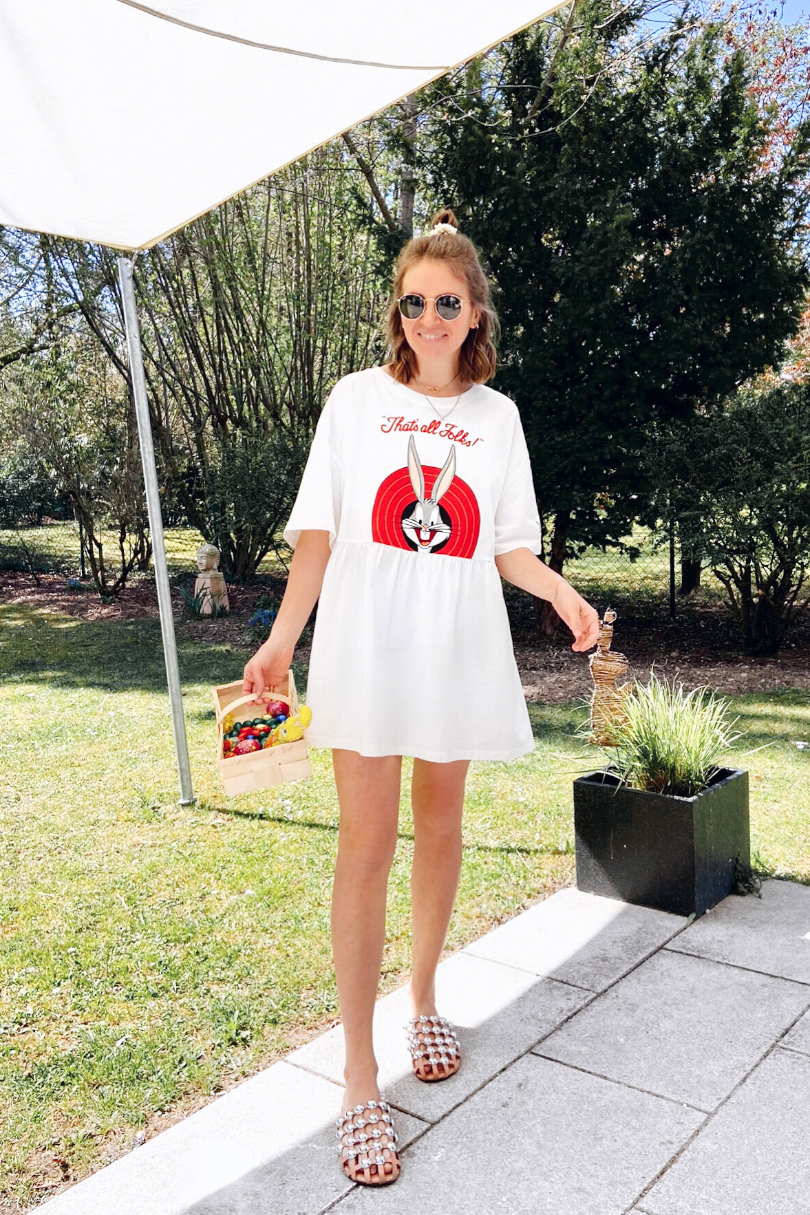Easter Holidays. Fashion and Style Blog Girl from Heartfelt Hunt. Girl with blonde half-up half-down hairstyle and pearl scrunchie wearing an oversized Bugs Bunny T-shirt and studded sandals.