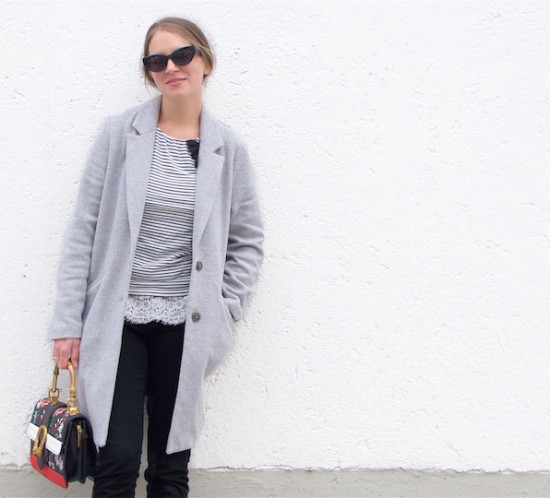 Embroidered Bag. Fashion Blogger Girl by Style Blog Heartfelt Hunt. Girl with blond, low messy bun wearing a gray coat, striped top, lace top, jeans, sunglasses, embroidered bag and Converse sneakers.