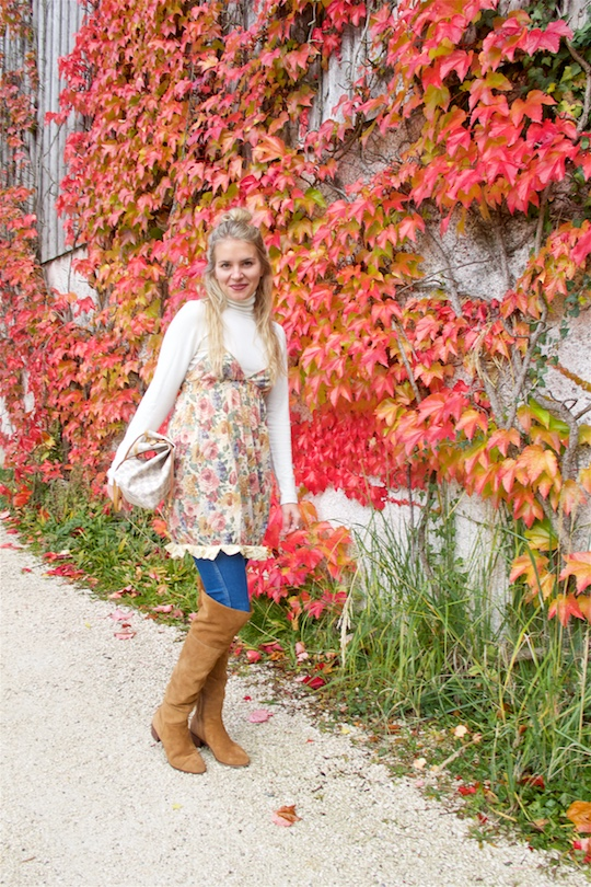Fall Transition. Fashion and Style Blog Girl from Heartfelt Hunt. Girl with blonde half-up half-down knot wearing a flower dress, turtleneck, destroyed jeans, Louis Vuitton bag and over the knee boots.