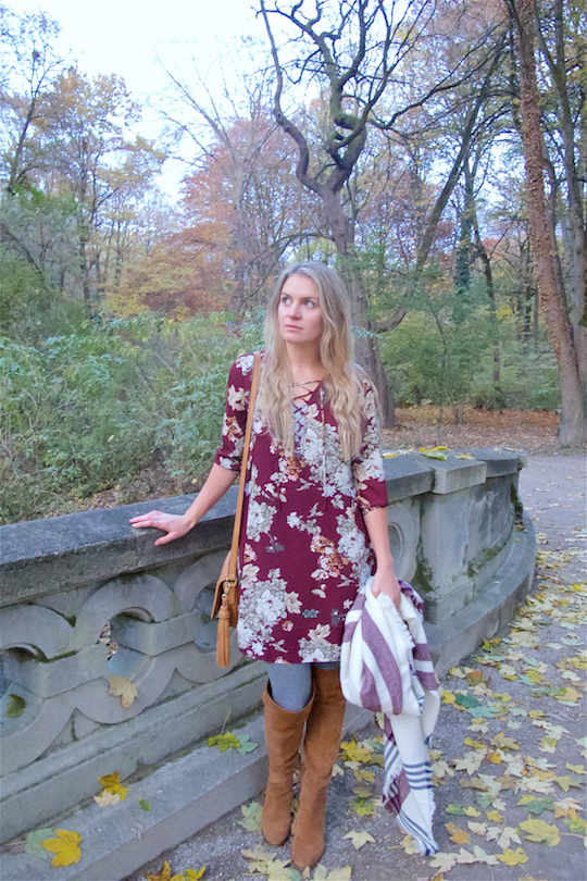 Fall Vibes. Fashion and Style Blog Girl from Heartfelt Hunt. Girl with blonde, loose curls wearing a floral dress, plaid scarf, tassel bag and suede thigh high boots.