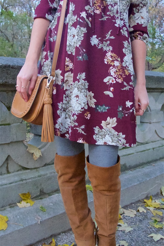 Fall Vibes. Fashion and Style Blog Girl from Heartfelt Hunt. Girl with blonde, loose curls wearing a floral dress, tassel bag and suede thigh high boots.