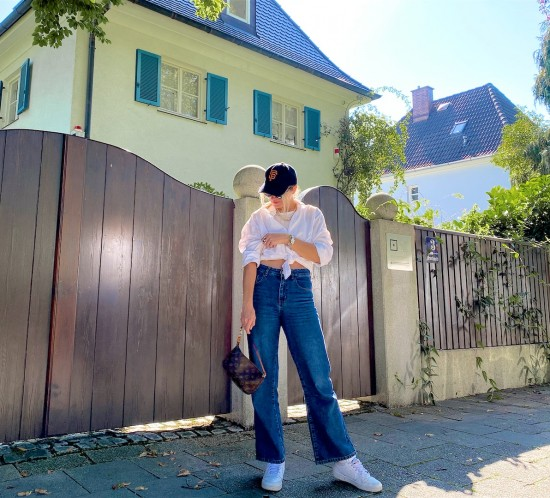 Fashion Basics. Fashion Blogger Girl by Style Blog Heartfelt Hunt. Girl with blond hair wearing a white shirt, wide leg jeans, white top, cap, cat-eye sunglasses, Louis Vuitton bag and Nike sneakers.
