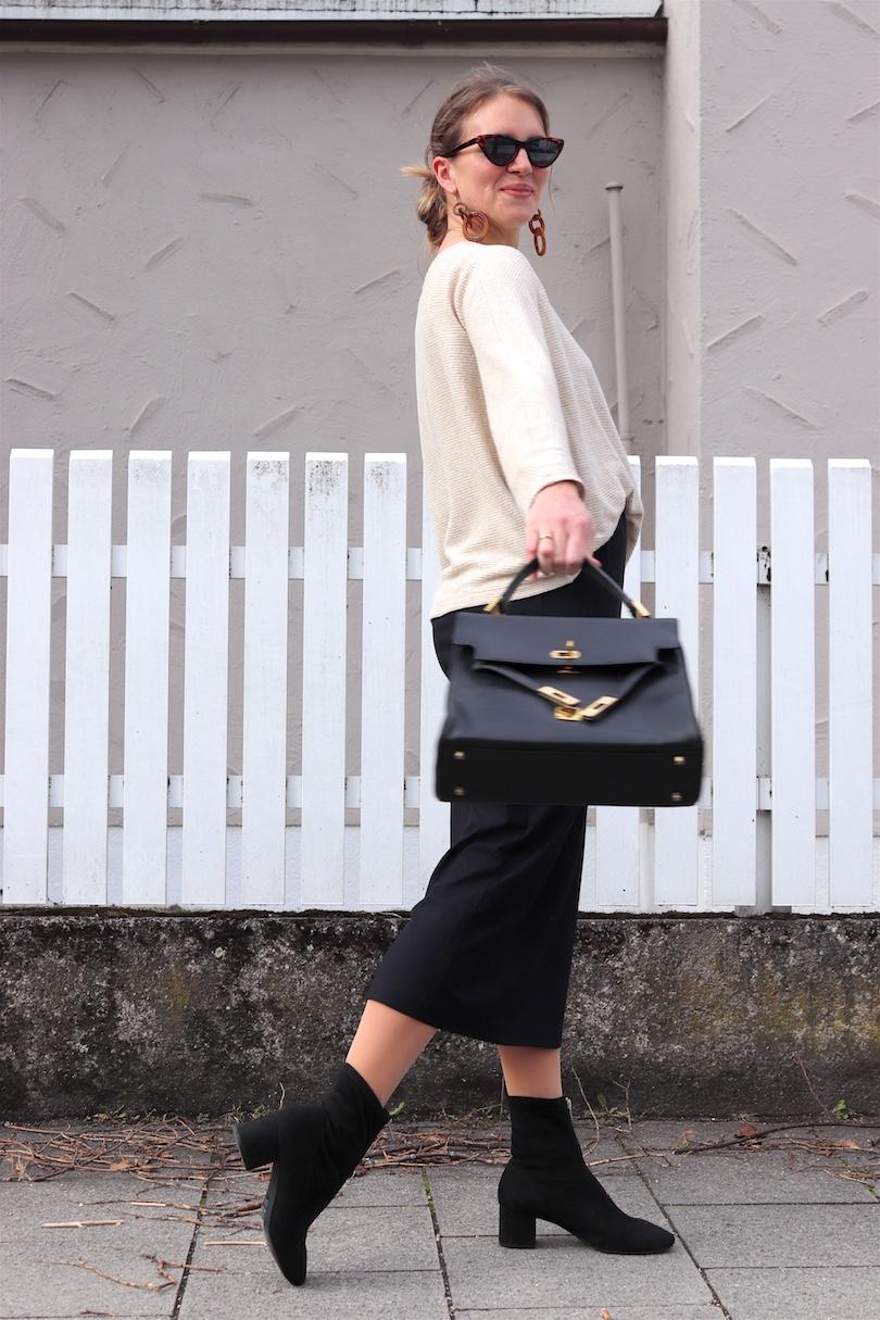 Fashion Basics. Fashion Blogger Girl by Style Blog Heartfelt Hunt. Girl with blond low bun wearing a basic sweater, basic pencil skirt, tortoiseshell sunglasses, tortoiseshell earrings, vintage MCM bag and sock boots.