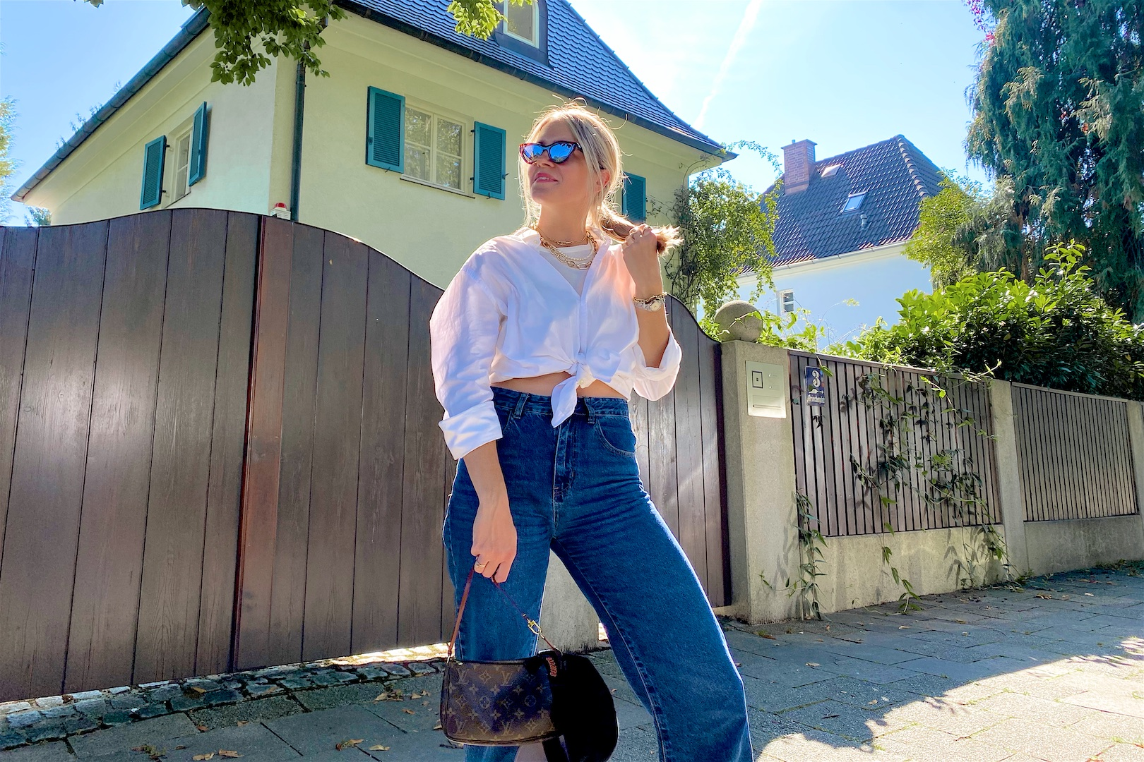 Fashion Basics. Fashion and Style Blog Girl from Heartfelt Hunt. Girl with blonde hair wearing a white shirt, wide leg jeans, white top, cap, cat-eye sunglasses, Louis Vuitton bag and Nike sneakers.