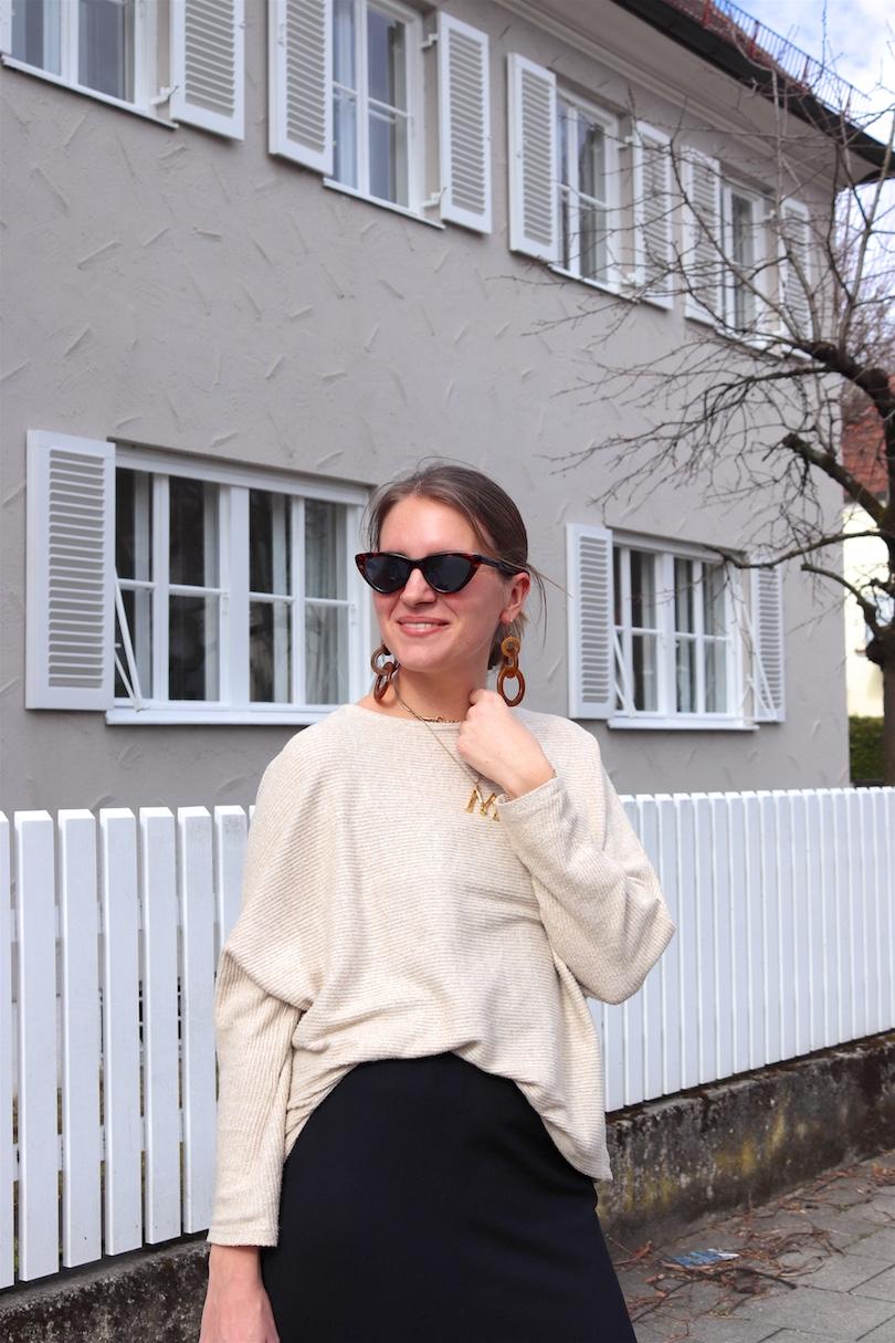 Fashion Basics. Fashion and Style Blog Girl from Heartfelt Hunt. Girl with blonde low bun wearing a basic sweater, basic pencil skirt, tortoiseshell sunglasses, tortoiseshell earrings, vintage MCM bag and sock boots.