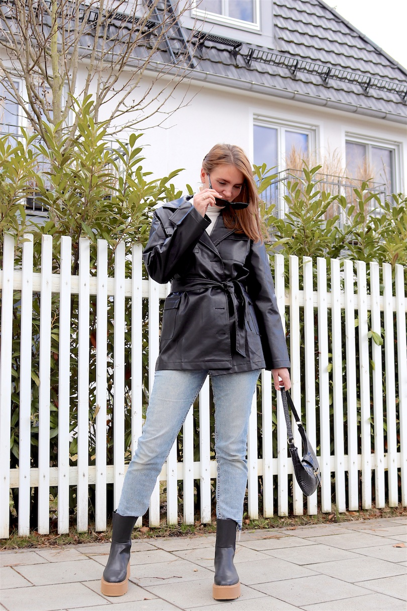Faux Leather Blazer. Fashion and Style Blog Girl from Heartfelt Hunt. Girl with blonde hair showing a faux leather blazer, white turtleneck, mom jeans, slim sunglasses, 90s bag and chunky chelsea boots.