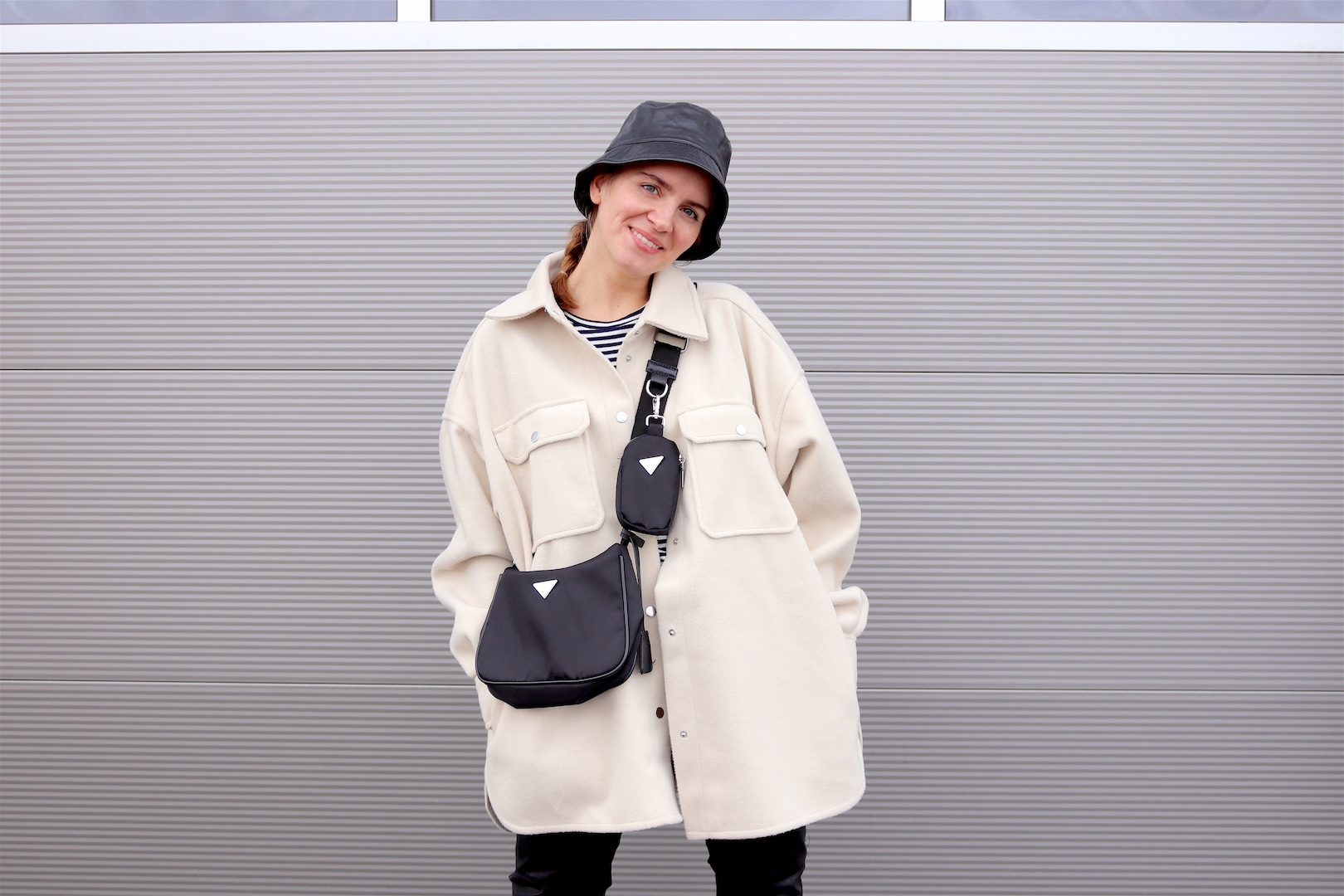 Faux Leather Look. Fashion and Style Blog Girl from Heartfelt Hunt. Girl with blonde braid wearing a faux leather bucket hat, shacket, striped tee, faux leather pants, 90s bag and faux leather combat boots.