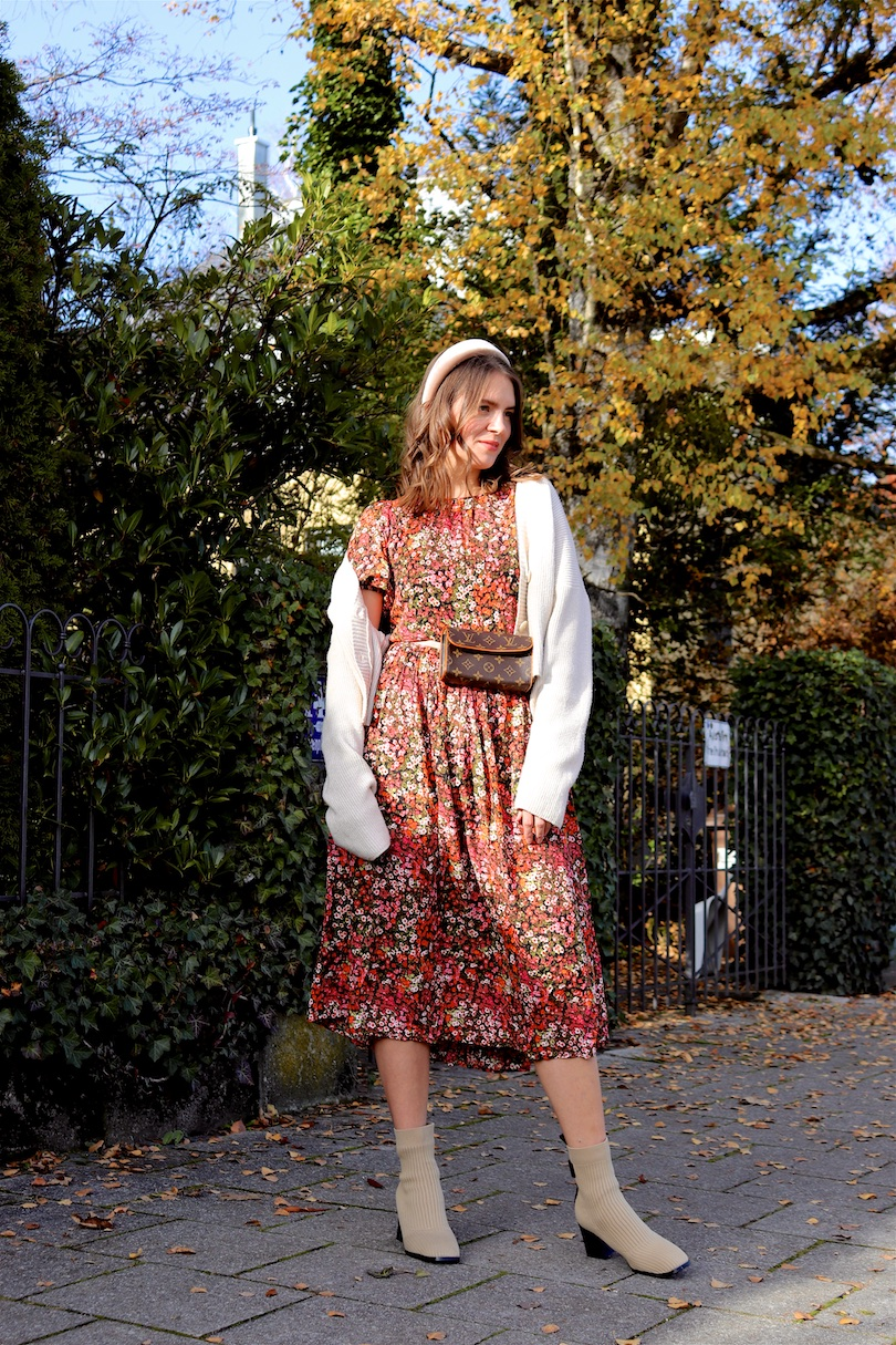 Floral Fall Dress. Fashion Blogger Girl by Style Blog Heartfelt Hunt. Girl with blond hair wearing a floral fall dress, chunky cardigan, velvet headband, vintage Louis Vuitton belt bag and booties.