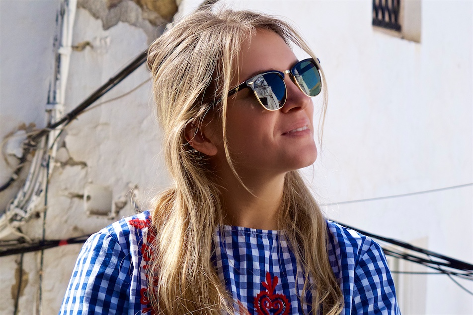 Floral Gingham. Fashion and Style Blog Girl from Heartfelt Hunt. Girl with blonde half-up half-down dutch braid wearing a floral gingham blouse, destroyed skinny jeans, Ray-Ban sunglasses, bag and studded boots.