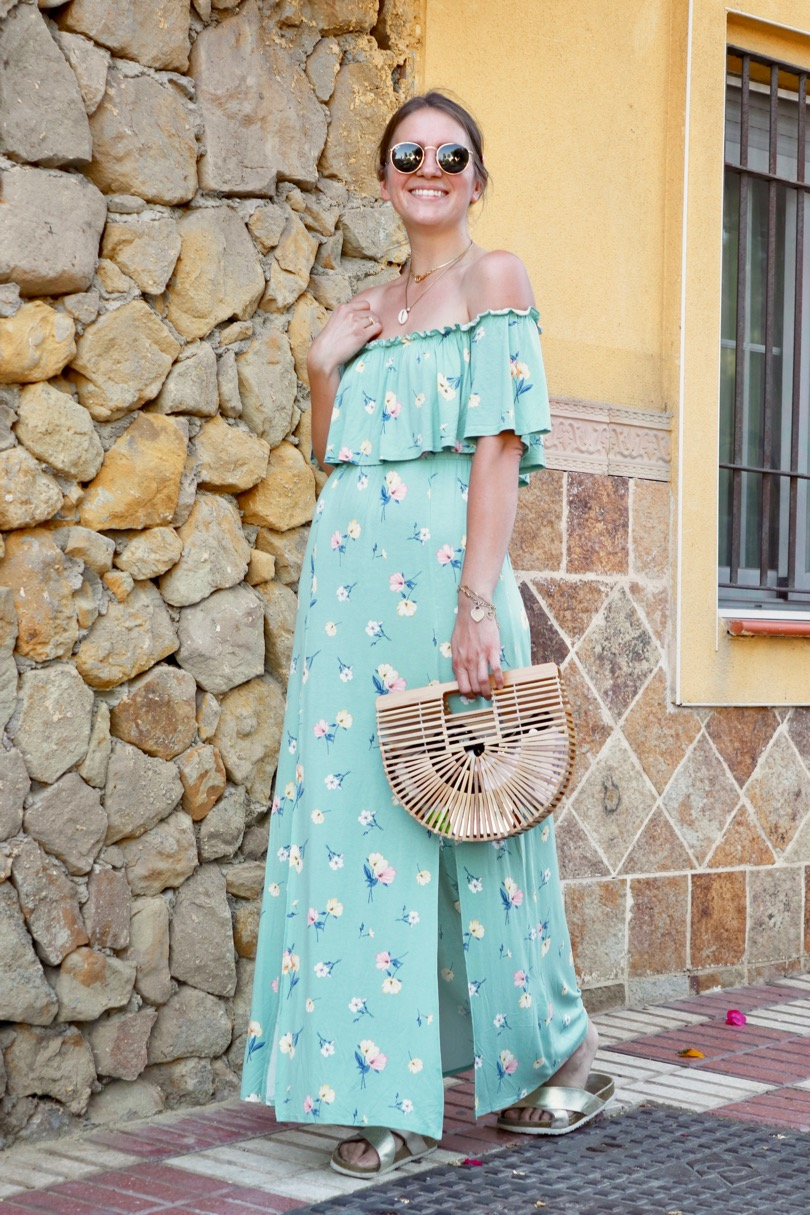 Floral Maxi Dress. Fashion and Style Blog Girl from Heartfelt Hunt. Girl with blonde low bun and pink hair clip wearing a floral maxi dress, Ray-Ban sunglasses, bamboo bag and golden sandals.