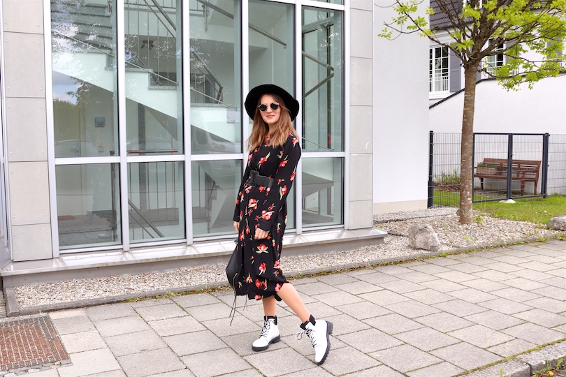 Floral Midi Dress. Fashion Blogger Girl by Style Blog Heartfelt Hunt. Girl with blond hair wearing a floral midi dress, black floppy hat, Ray-Ban sunglasses, Rebecca Minkoff backpack and white boots.