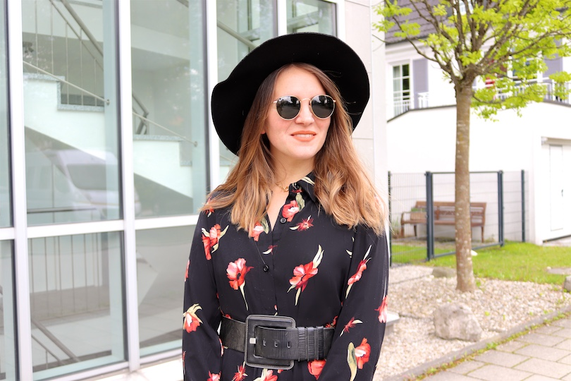 Floral Midi Dress. Fashion and Style Blog Girl from Heartfelt Hunt. Girl with blonde hair wearing a floral midi dress, black floppy hat, Ray-Ban sunglasses, Rebecca Minkoff backpack and white boots.