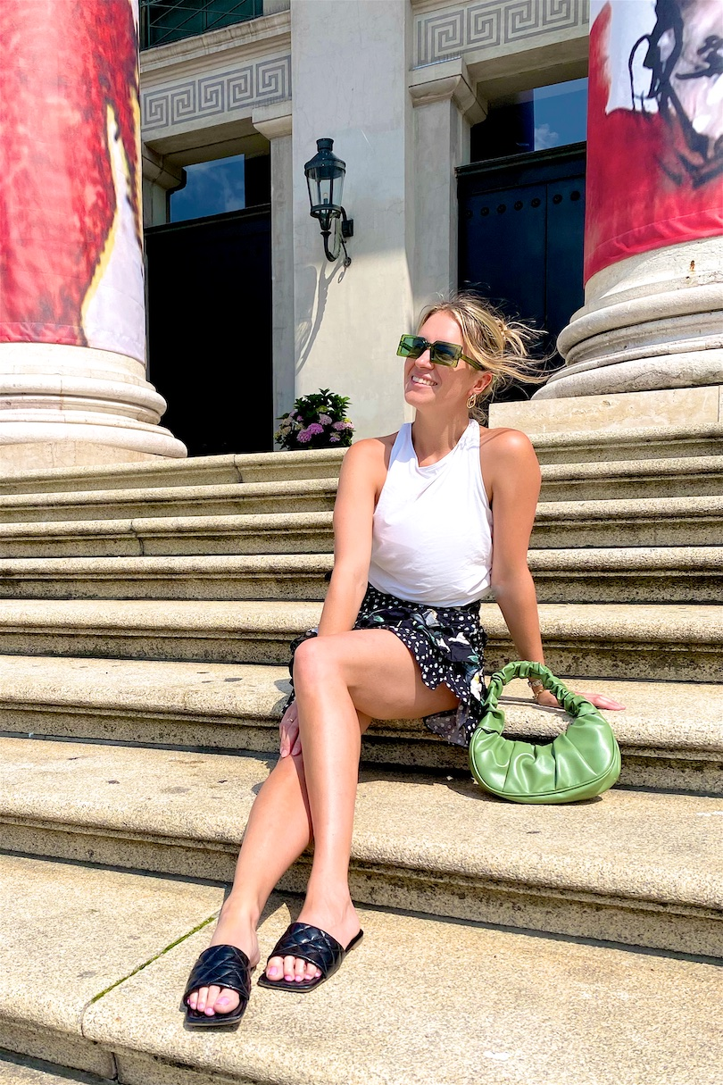 Floral Mini Skirt. Fashion and Style Blog Girl from Heartfelt Hunt. Girl with blonde hair and green hair claw clip wearing a floral mini skirt, DIY summer top, green sunglasses, green ruched bag and padded sandals.