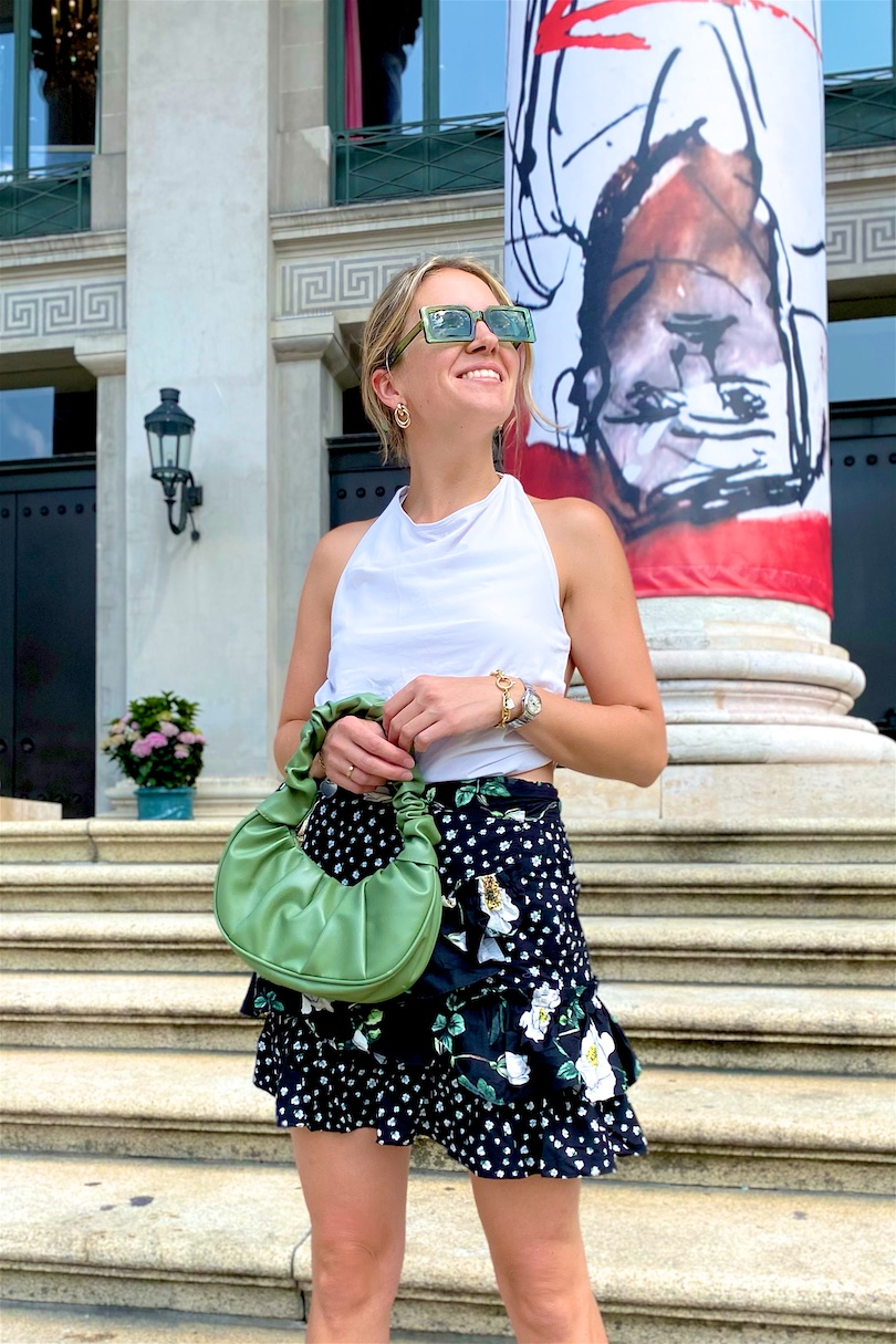 Floral Mini Skirt. Fashion Blogger Girl by Style Blog Heartfelt Hunt. Girl with blond hair and green hair claw clip wearing a floral mini skirt, DIY summer top, green sunglasses, green ruched bag and padded sandals.
