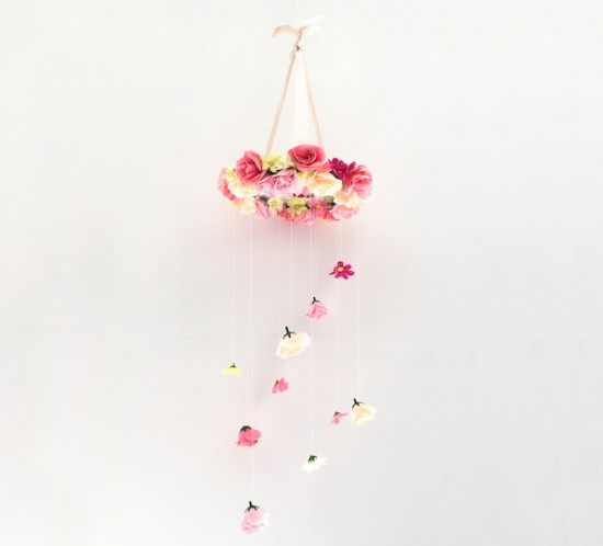 Flower Chandelier DIY. Fashion Blogger Girl by Style Blog Heartfelt Hunt showing a diy for a flower chandelier.