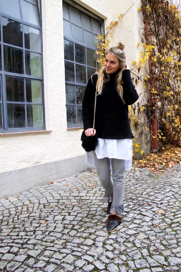 Fringe Jeans. Fashion and Style Blog Girl from Heartfelt Hunt. Girl with blonde half-up half-down knot wearing an oversized turtleneck, long blouse, fringe jeans, faux fur bag and mules.