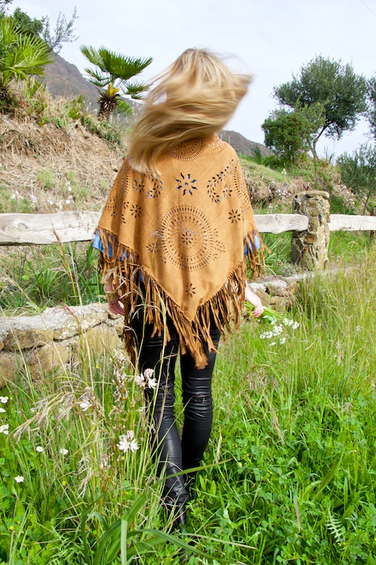 Fringe Shawl. Fashion Blogger Girl by Style Blog Heartfelt Hunt. Girl wearing a fringe shawl, denim off-shoulder blouse, black jeans and chelsea boots.