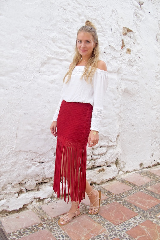 Fringe Skirt. Fashion and Style Blog Girl from Heartfelt Hunt. Girl with blonde half-up half-down knot wearing a red fringe skirt, white off-shoulder top, vintage Chanel bag and lace up sandals.