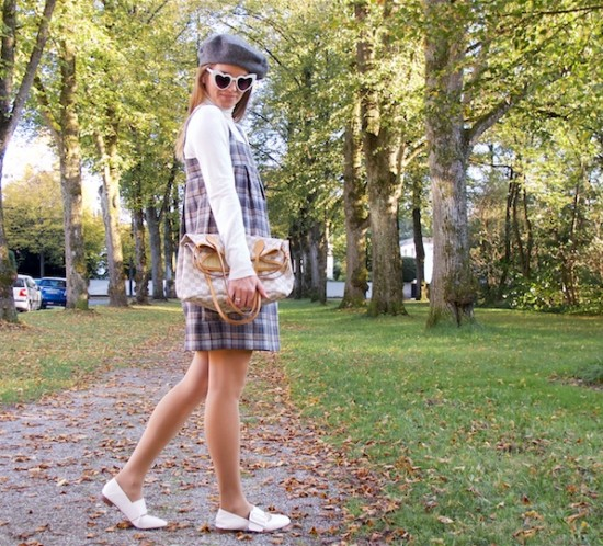 Gray Checked Dress. Fashion Blogger Girl by Style Blog Heartfelt Hunt. Girl with blond hair wearing a gray checked dress, turtleneck sweater, heart shaped sunglasses, beret, Louis Vuitton bag and flats.