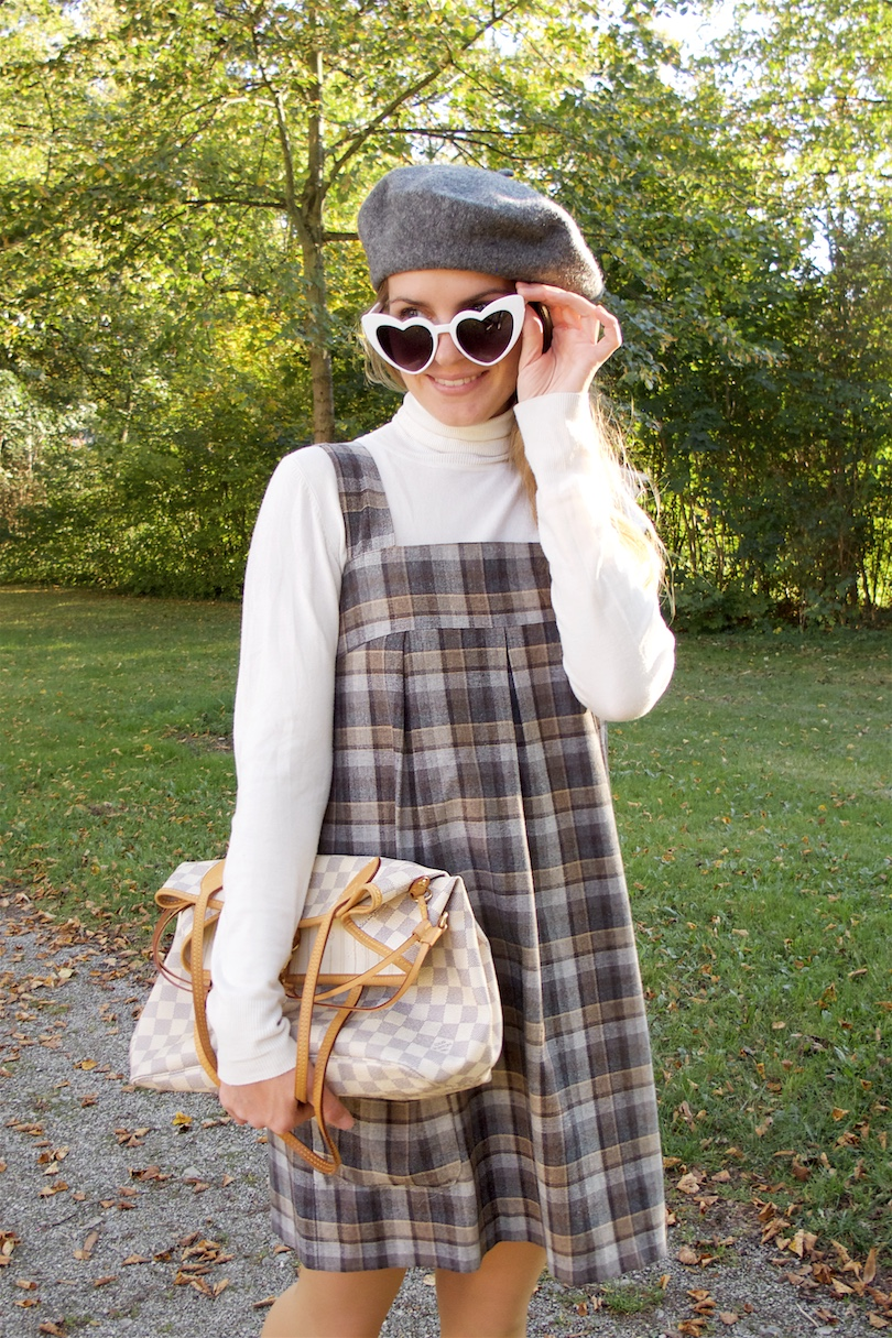 Gray Checked Dress. Fashion and Style Blog Girl from Heartfelt Hunt. Girl with blonde hair wearing a gray checked dress, turtleneck sweater, heart shaped sunglasses, beret, Louis Vuitton bag and flats.