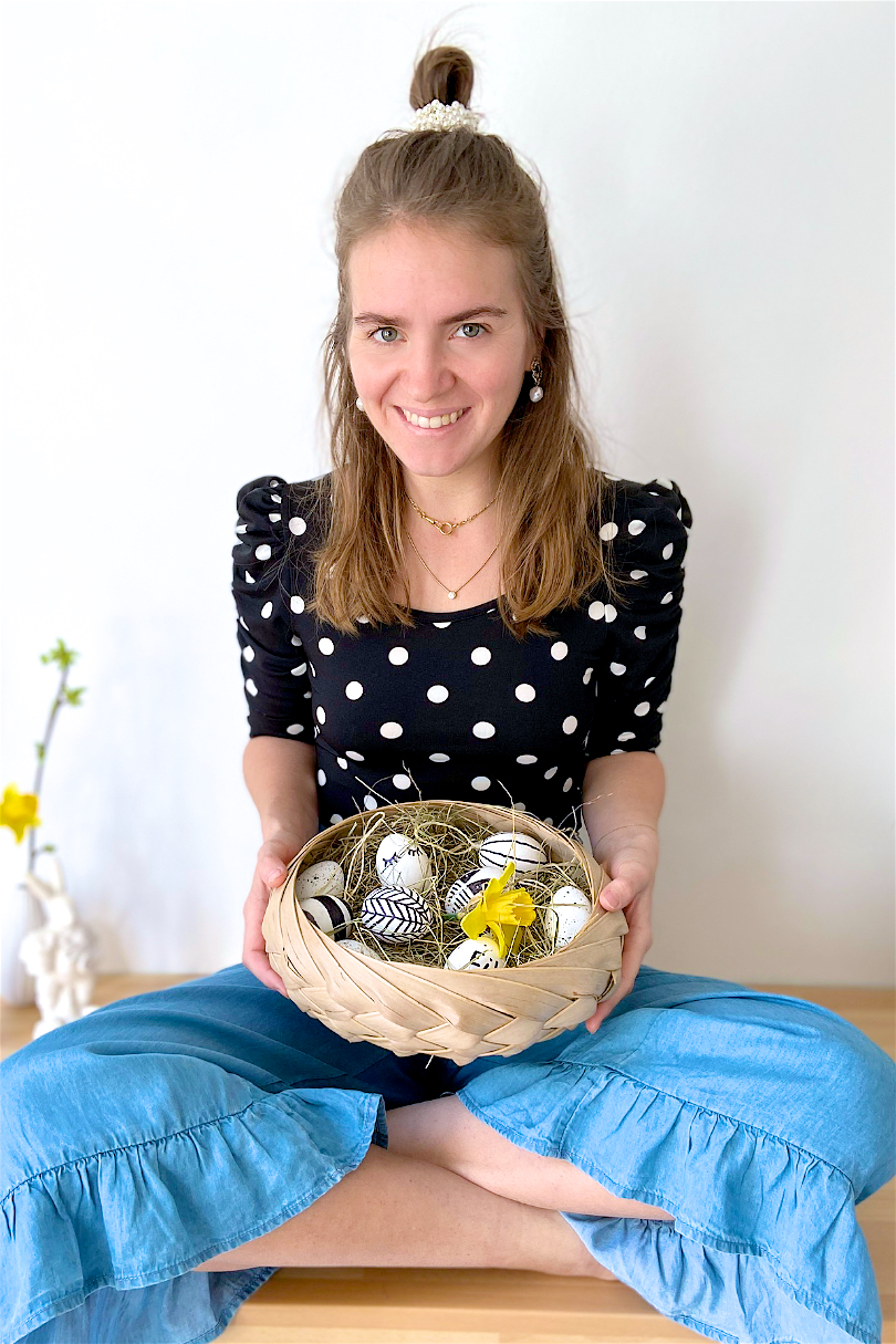 Happy Easter 2020. Fashion and Style Blog Girl from Heartfelt Hunt. Girl with blonde half-up half-down hairstyle and pearl scrunchie wearing a polka dot bodysuit and blue culottes.