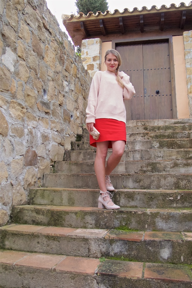 Happy Valentine's Day. Fashion Blogger Girl by Style Blog Heartfelt Hunt. Girl with blond dutch side braid wearing a red dress, pink sweater, pink clutch with flowers and pink lace up shoes.