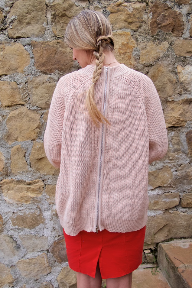 Happy Valentine's Day. Fashion and Style Blog Girl from Heartfelt Hunt. Girl with blonde dutch side braid wearing a red dress, pink sweater, pink clutch with flowers and pink lace up shoes.