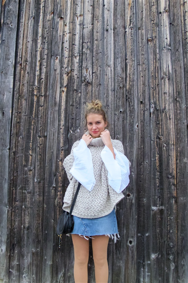 Heavy Knit. Fashion Blogger Girl by Style Blog Heartfelt Hunt. Girl with blond messy bun wearing a heavy knit sweater, bell sleeve blouse, denim skirt, Chloé bag and shoes with platform heels.