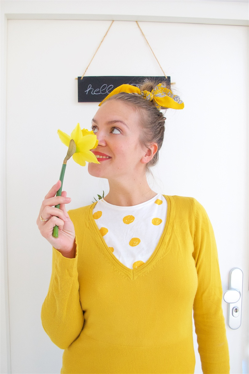 Hello Spring. Fashion and Style Blog Girl from Heartfelt Hunt. Girl with blonde, high messy bun and a yellow scarf in her hair wearing a t-shirt with polka dots and yellow sweater.