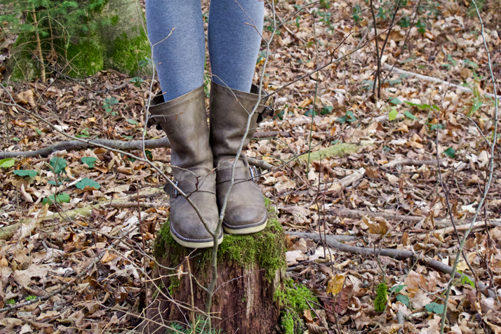 Boots of fashion and style blogger girl in closeup view in the woods