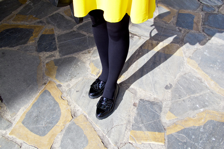 Fashion and style blogger girl's glossy loafers in closeup view