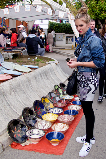 Blond fashion and style blogger girl shopping at a weekly market in Spain, wearing a lace dress, denim jacket, Michael Kors bag and adidas sneakers