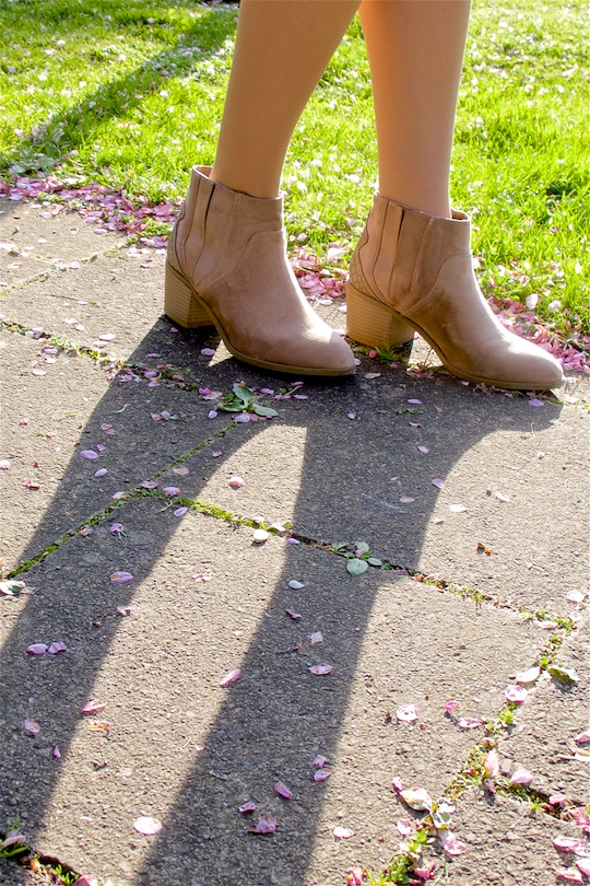 Fashion and style blogger girl in closeup view, wearing boots