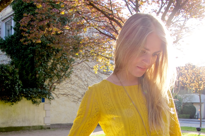 Blonde fashion and style blogger girl wearing a yellow lace dress