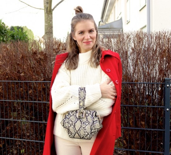 Holiday Season Whites. Fashion Blogger Girl by Style Blog Heartfelt Hunt. Girl with blond half-up half-down messy bun wearing an off-white chunky sweater, off-white corduroy pants, red coat, snake print bag and black sock boots.