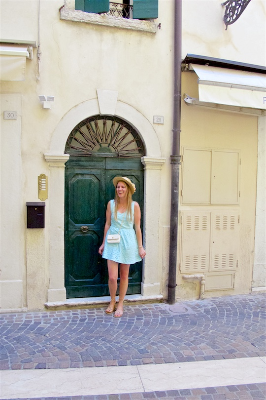 Italian Road Trip. Fashion and Style Blog Girl from Heartfelt Hunt. Girl with long, blonde hair wearing a lace dress, straw hat, vintage Chanel bag and sandals.