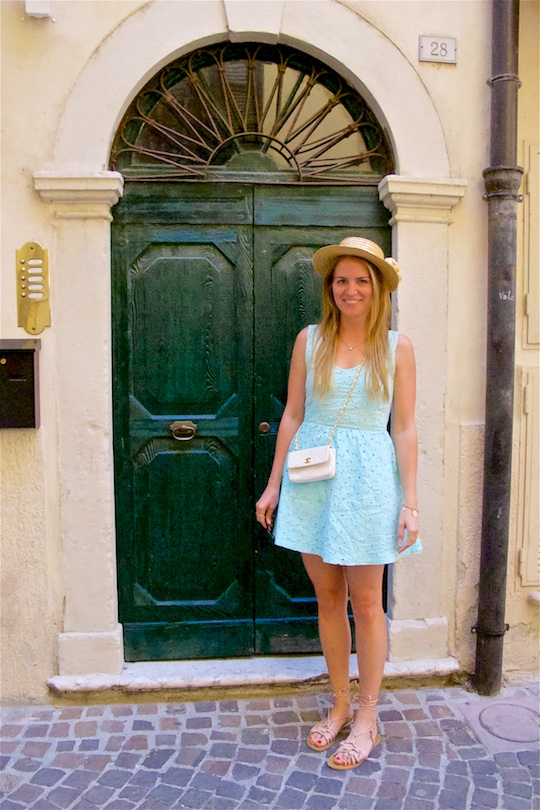 Italian Road Trip. Fashion Blogger Girl by Style Blog Heartfelt Hunt. Girl with long, blond hair wearing a lace dress, straw hat, vintage Chanel bag and sandals.