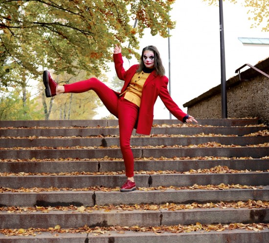Joker Halloween Costume. Fashion Blogger Girl by Style Blog Heartfelt Hunt. Girl with blond hair wearing a red suit, yellow vest, blue shirt and brown brogues for her Joker Halloween costume.