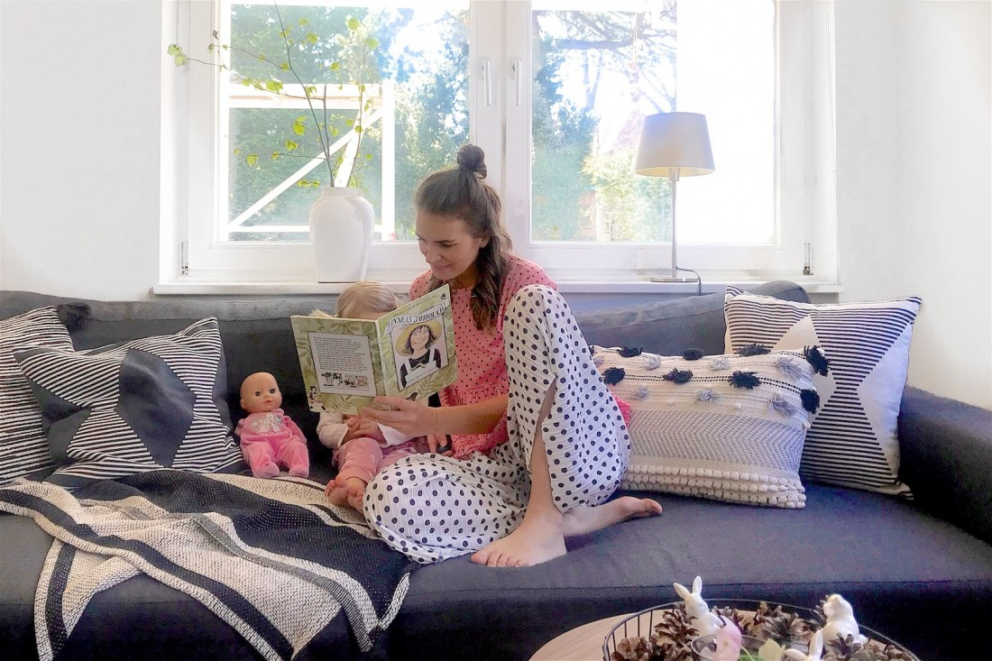 Kids Home Activities. Fashion Blogger Girl by Style Blog Heartfelt Hunt. Girl with blond hair showing some kids' home activities wearing a pink polka dot tee and polka dot pants and the little one's wearing a polka dot jumpsuit.
