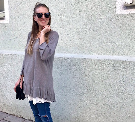 Layering Look. Fashion Blogger Girl by Style Blog Heartfelt Hunt. Girl with blond, loose curls and half-up half-down bun wearing a sweater with ruffle, lace dress, destroyed jeans, bag and adidas sneakers.