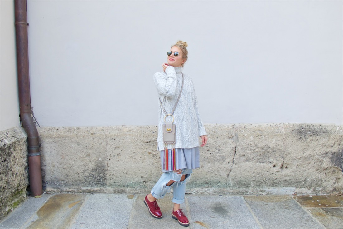 Layers. Fashion Blogger Girl by Style Blog Heartfelt Hunt. Girl with blond upside down braided bun wearing an oversized sweater, dress, destroyed jeans, Chloé bag, Ray-Ban sunglasses and burgundy brogues.